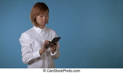 beautiful girl holding smartphone and credit card - portrait...