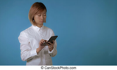 beautiful girl holding smartphone and credit card