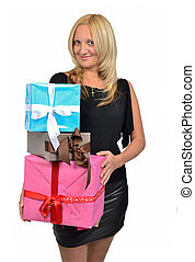 Beautiful girl holding stack of gift boxes