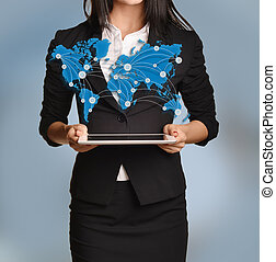 Beautiful girl holding tablet with world map and links between the points