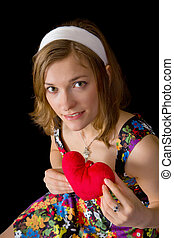 Beautiful girl holding toy heart