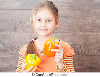 beautiful girl holding vegetables