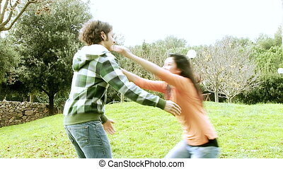 Happy couple hugging in park slow motion