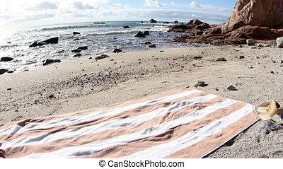 beautiful girl in a bikini sunbaths on the beach at sunrise,...