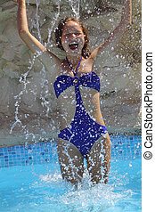 beautiful girl in a blue a swimsuit laughs