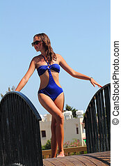 beautiful girl in a blue a swimsuit
