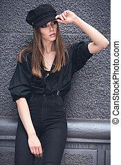 Beautiful girl in a cap.