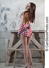 beautiful girl in a checkered shirt
