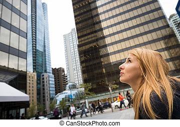 Beautiful girl in a city
