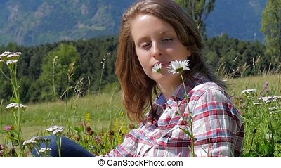 beautiful girl in a daisy field