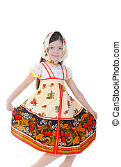 Beautiful girl in a dress dances.