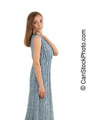 Beautiful girl in a dress. Studio.