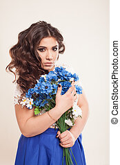 beautiful girl in a dress with blue flowers