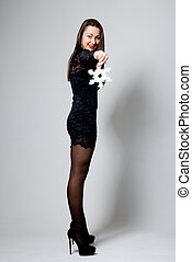Beautiful girl in a dress with snowflakes