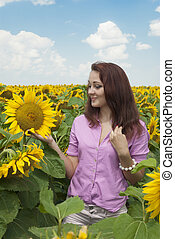 Beautiful girl in a field of sunflowers.