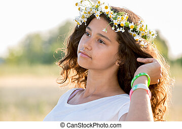 Beautiful girl in a field on  summer day
