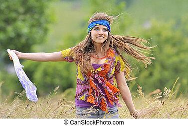 Beautiful girl in a field