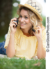 beautiful girl in a field talking on the phone