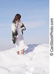 girl in a fur coat in the winter