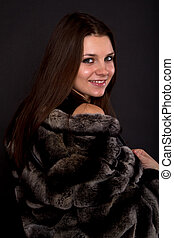 beautiful girl in a fur coat