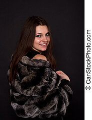 beautiful girl in a fur coat