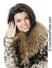 Beautiful girl in a fur hood - The beautiful girl in a fur...