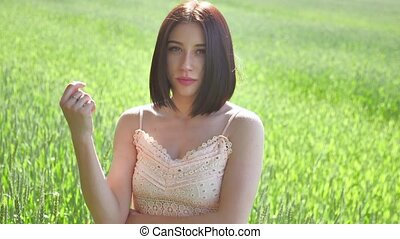 Beautiful girl in a green field with wheat. Grass lifestyle woman field nature