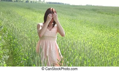 Beautiful girl in a green field with wheat. Grass woman lifestyle field nature