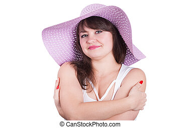 Beautiful girl in a hat on a white background.