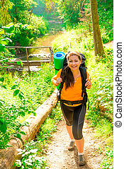 beautiful girl in a hike and green summer forest