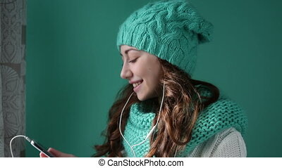 Beautiful girl in a knitted hat