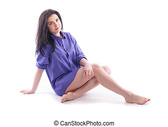 Beautiful girl in a man's shirt on a white background