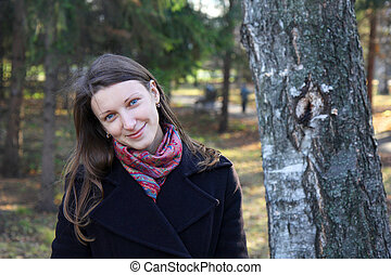 beautiful girl in a park on autumn-day