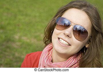 Beautiful girl in a park smiling.