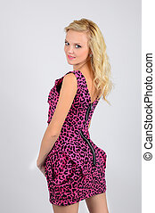 Beautiful girl in a pink dress