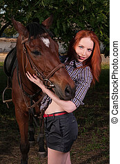 girl in a shirt and a horse