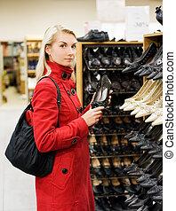 Beautiful girl in a shop