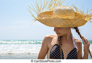 Beautiful girl in a straw hat