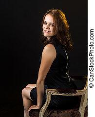 Beautiful girl in a tight-fitting dress