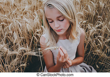 Beautiful girl in a wheat field.