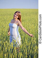 Beautiful girl in a wheat field