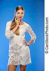 Beautiful girl in a white dress.