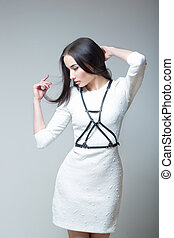girl in a white dress with straps