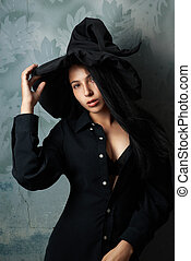 girl in a witch costume sexy looks