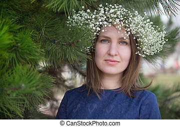 beautiful girl in a wreath