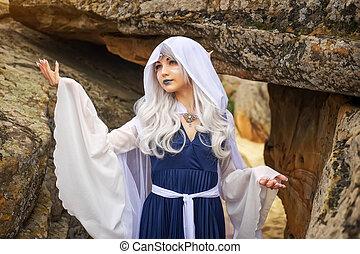 Beautiful Girl In an elf costume near the rocks