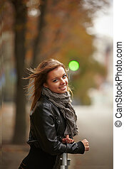 Beautiful girl in autumn city