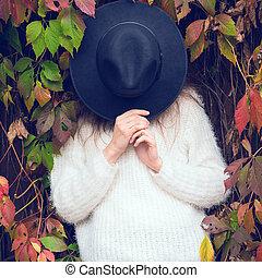 Beautiful girl in autumn leaves