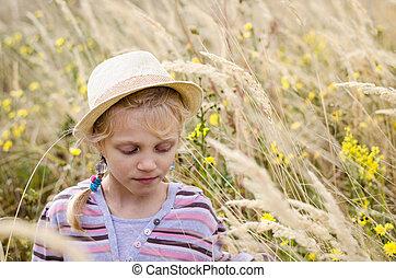 girl in autumn meadow