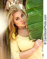 Beautiful girl in bananas plantation